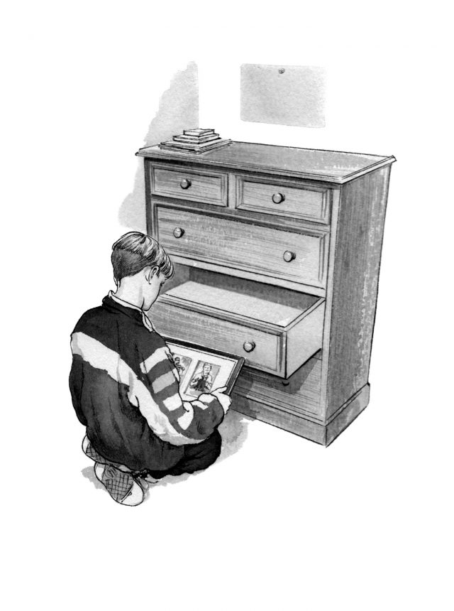Boy at open drawer